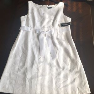 Jessica Howard white dress with a ribbon.